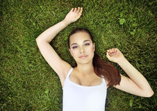Beautiful young girl lying on the grass Royalty Free Stock Photo