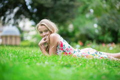 Beautiful young girl lying on the grass Stock Photography