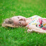 Beautiful young girl lying on the grass Stock Photo