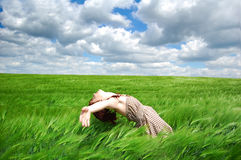 Beautiful young girl lying at green field, Royalty Free Stock Photos
