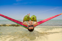 Beautiful young girl lying in a hammock holding Royalty Free Stock Photo