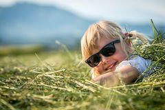 Beautiful young Girl Lying On The Meadow And Dreaming Stock Photos