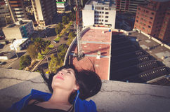 Beautiful young girl lying on the roof Stock Photography