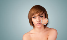 Beautiful young girl with magnifying glass of skin damage Royalty Free Stock Photography