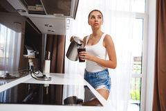Beautiful young girl make coffee Stock Image