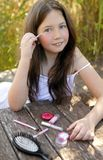Beautiful young girl with make up set outdoors Stock Photos