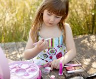 Beautiful young girl with make up set outdoors. Beautiful young girl portrait with make up set outdoors, at the park Stock Image