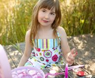Beautiful young girl with make up set outdoors Stock Photography