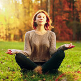 Beautiful young girl meditating Royalty Free Stock Photos