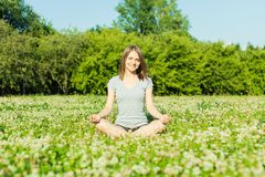 Beautiful young girl meditating in autumn park Royalty Free Stock Image