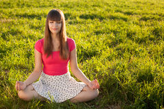 Beautiful young girl meditating Stock Photos