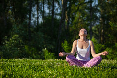 Beautiful young girl meditating in park Royalty Free Stock Photo