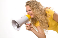 Beautiful young girl with megaphone over white Stock Photo