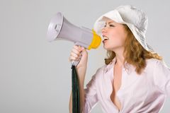 Beautiful young girl with megaphone on white Royalty Free Stock Image