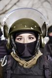 The beautiful young girl in a military uniform and a helmet Royalty Free Stock Photography