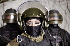 The beautiful young girl in a military uniform and a helmet Stock Image
