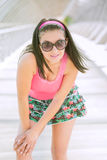 Beautiful young girl in a miniskirt Stock Image