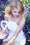 Beautiful young girl with mirror near blooming lavender Royalty Free Stock Images