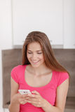 Beautiful young girl with a mobile phone. Royalty Free Stock Photos