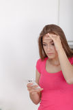Beautiful young girl with a mobile phone. Stock Photo