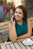 Beautiful young girl with a mobile phone Royalty Free Stock Image