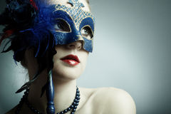 The beautiful young girl in a mysterious mask Stock Photo