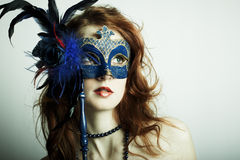 The beautiful young girl in a mysterious mask Stock Photography