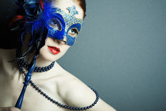 The beautiful young girl in a mysterious mask Royalty Free Stock Photos