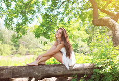Beautiful young girl on the nature in sunny summer Royalty Free Stock Images