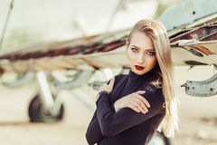 Beautiful young girl near the airplane Royalty Free Stock Image