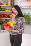 Beautiful young girl near the Fridge with healthy food. Stock Photos