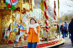 Beautiful young girl near merry-go-round Royalty Free Stock Photos