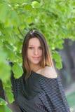 Beautiful young girl near tree Royalty Free Stock Photos