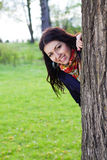 Beautiful young girl near tree Royalty Free Stock Photos