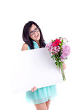 Beautiful young girl. Beautiful young nerd girl with flowers in summer dress holding a white sign/hiding behind a white sign Royalty Free Stock Images