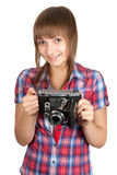 Beautiful young girl with old camera Royalty Free Stock Image