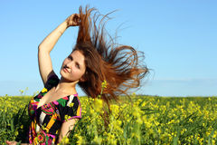 Beautiful Young Girl On The Yellow Meadow Royalty Free Stock Photography
