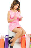 Beautiful young girl opening her birthday present isolated on wh Stock Photography