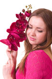 Beautiful young girl with orchid Royalty Free Stock Images