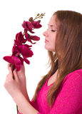 Beautiful young girl with orchid Royalty Free Stock Photos