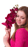Beautiful young girl with orchid Stock Image
