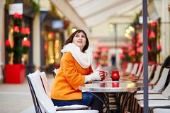 Beautiful young girl in an outdoor Parisian cafe Royalty Free Stock Photos