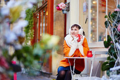 Beautiful young girl in an outdoor Parisian cafe Stock Photo