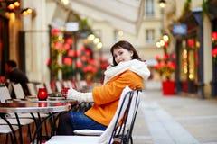 Beautiful young girl in an outdoor Parisian cafe Stock Photo