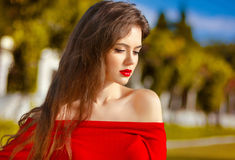 Beautiful young girl Outdoor portrait. Attractive Woman with red Stock Image