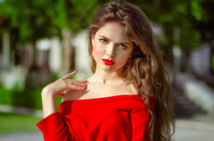 Beautiful young girl Outdoor portrait. Fashion brunette in red d Royalty Free Stock Photography