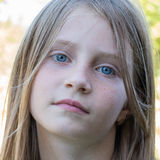 Beautiful young girl outdoors, portrait children close up Royalty Free Stock Image