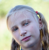 Beautiful young girl outdoors, portrait children close up Royalty Free Stock Photo
