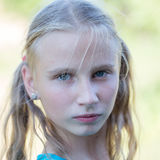 Beautiful young girl outdoors, portrait children close up Stock Photos