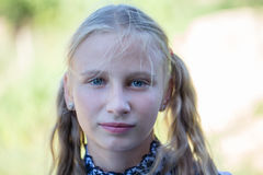 Beautiful young girl outdoors, portrait children close up Stock Photography